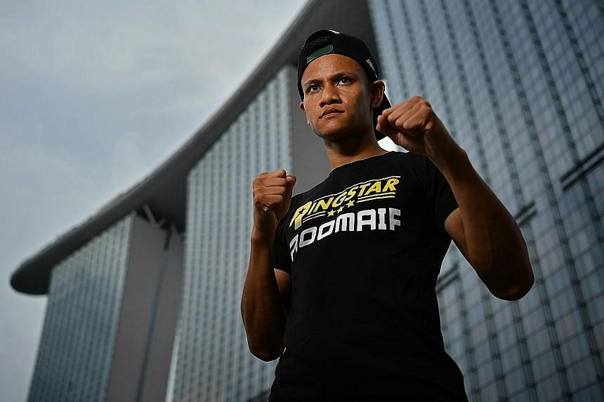 Singapore's top professional boxer Muhamad Ridhwan posing in front of Marina Bay Sands ahead of his International Boxing Organisation super bantamweight world title fight against Namibian Paulus Ambunda at the Roar of Singapore V: The Kings of Lion C