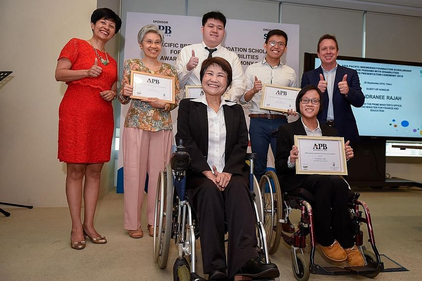 At yesterday's event are (back row from left) Ms Indranee Rajah, Minister in the Prime Minister's Office; Mrs Lee Sok Fun, mother of scholarship recipient Lionel Lee (not present at the ceremony); Mr Caleb Tay; Mr Justin Kueh; APB Singapore managing