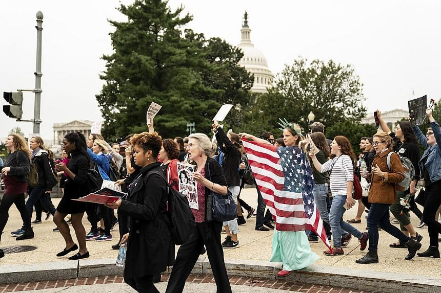 Protesters marching near the Supreme Court as Dr Christine Blasey Ford, who has accused US President Donald Trump's Supreme Court nominee Brett Kavanaugh of a sexual assault, gives her testimony in the Senate.