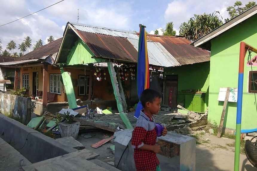 A still shot from a video on social media apparently showing a tsunami triggered by a magnitude-7.5 earthquake in Sulawesi yesterday. A collapsed house following an earthquake in Donggala, Central Sulawesi, yesterday. The quake hit as dusk fell, and