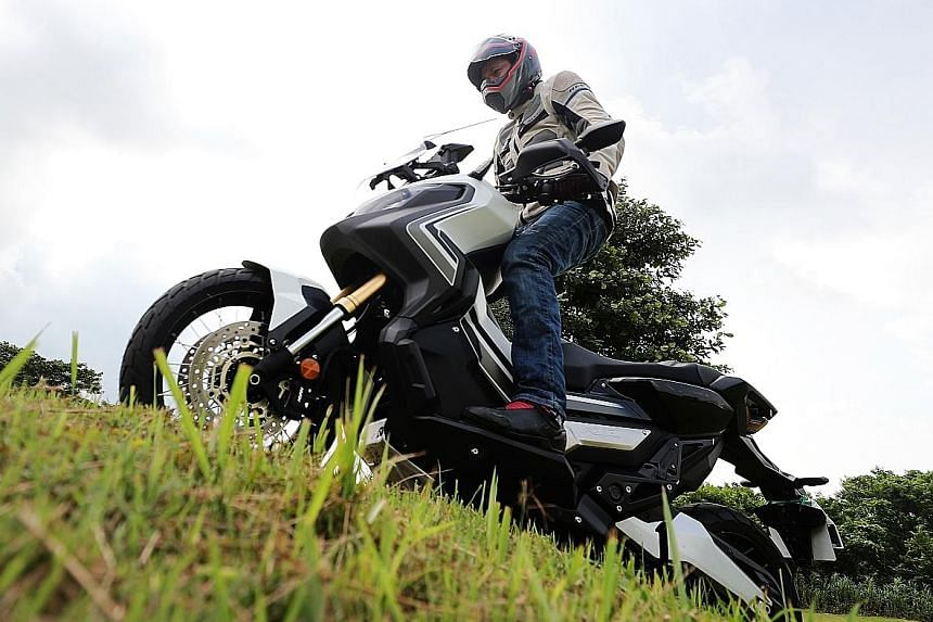 Be careful when riding up a slope or attempting to take a jump on the X-ADV. Without aftermarket footpegs which shift the rider's position rearwards, taking a jump could result in the windscreen hitting your chest.