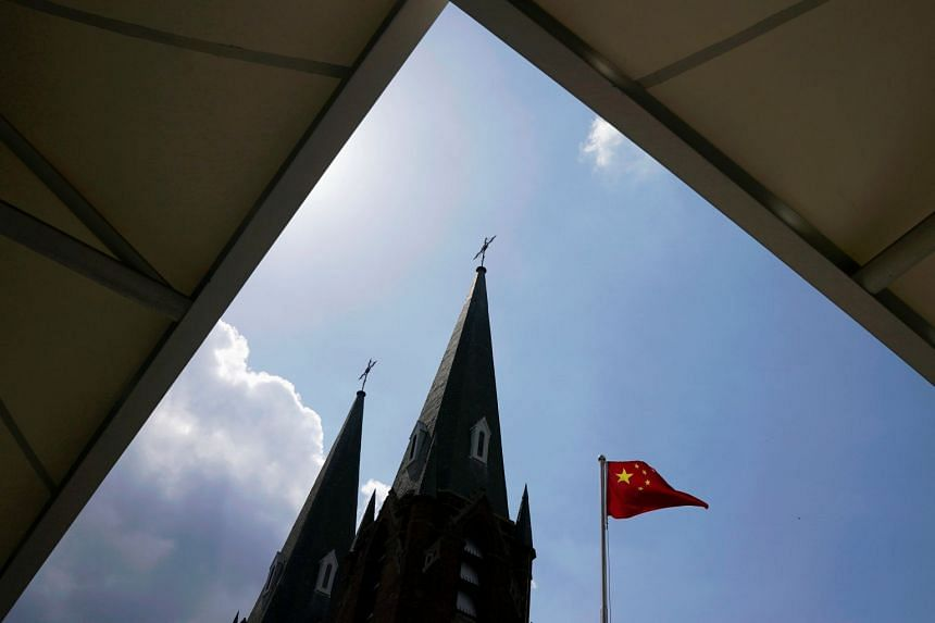 A Chinese flag flutters in the wind in Shanghai. China says it faces a threat not only from local Islamists in Xinjiang, but also from militants in the Middle East.