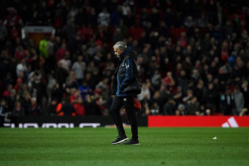 Manchester United manager Jose Mourinho leaves the pitch following an English League match against Derby County at Old Trafford in Manchester, England, on Sept 25, 2018.