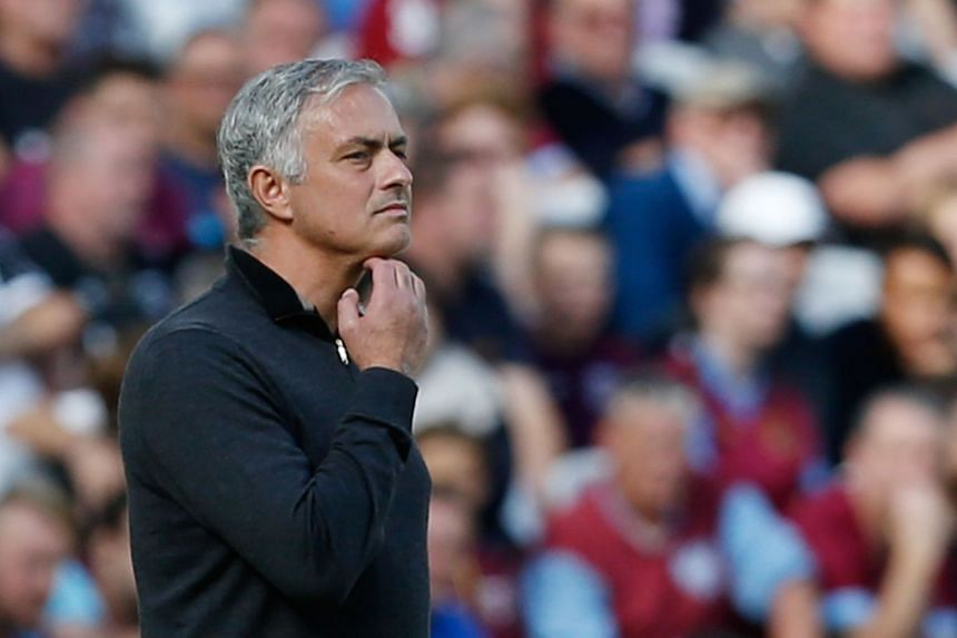 Manchester United's Portuguese manager Jose Mourinho gestures on the touchline during the English Premier League football match between West Ham United and Manchester United at The London Stadium, in east London on Sept 29, 2018.