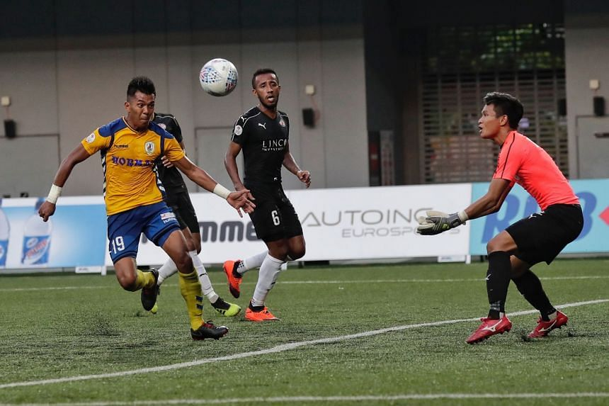 Tampines Rovers' Khairul Amri (left) challenges Home United's goalkeeper Kenji Rusydi (right) for the ball during the Singapore Premier League match at Our Tampines Hub on Sept 29, 2018.