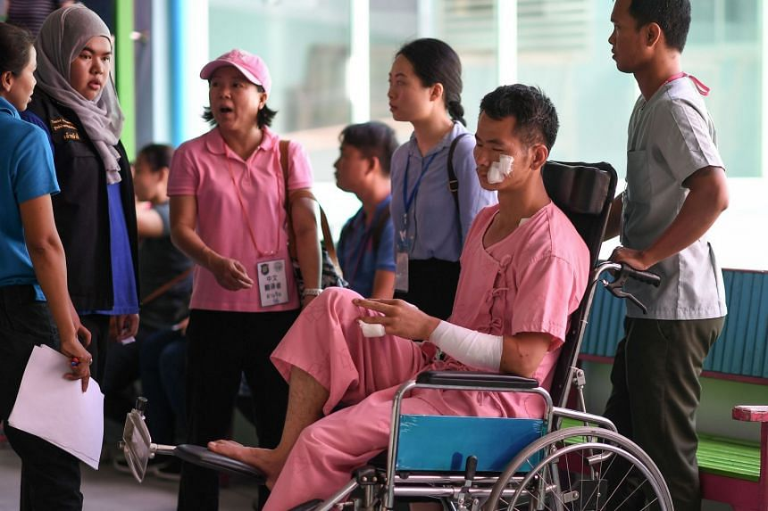 Huang Junxiong, a Chinese survivor, sits in a wheelchair at the Vachira Phuket Hospital in Phuket on July 8, 2018, after a tourist boat carrying mostly Chinese tourists capsized in rough seas on July 5.