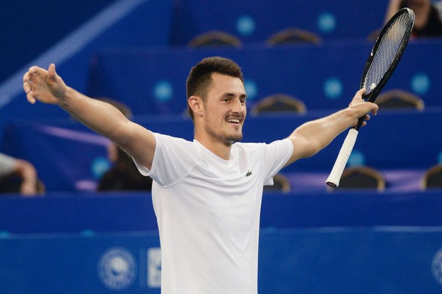 Tomic reacts after winning his men's singles semi-final match against Joao Sousa of Portugal.