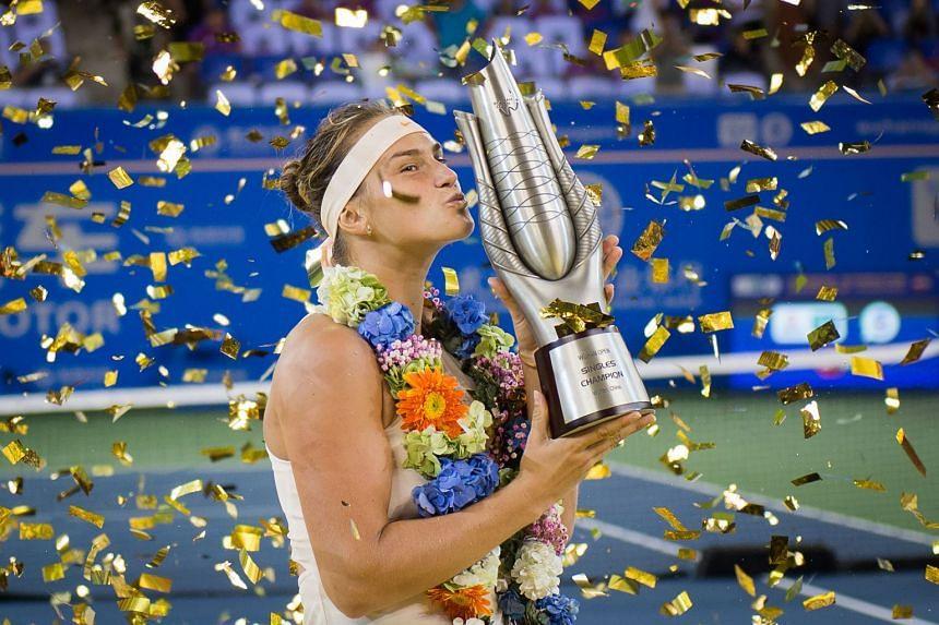 Aryna Sabalenka of Belarus kisses the trophy after winning the WTA Wuhan Open.