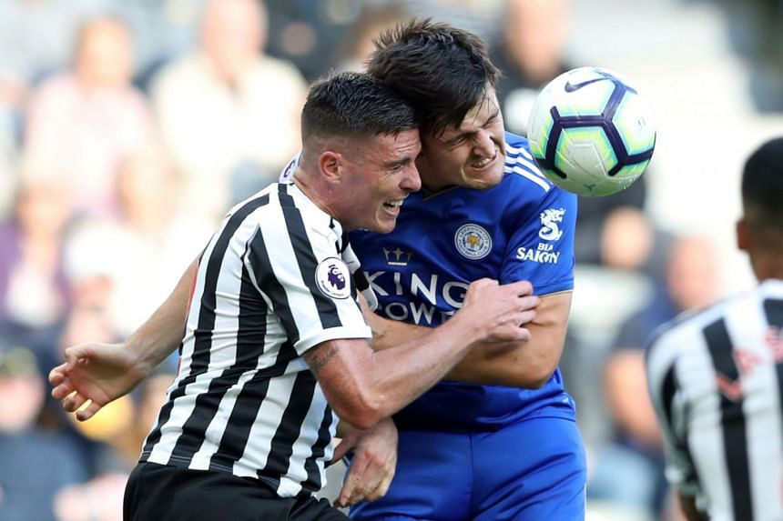 Leicester City's Harry Maguire in action with Newcastle United's Ciaran Clark.