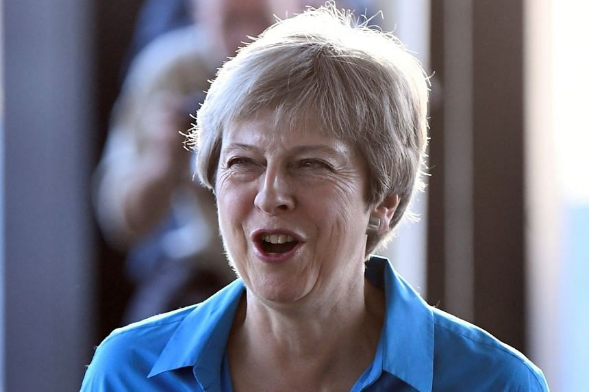 Theresa May arrives for the Conservative Party Conference in Birmingham, Britain.