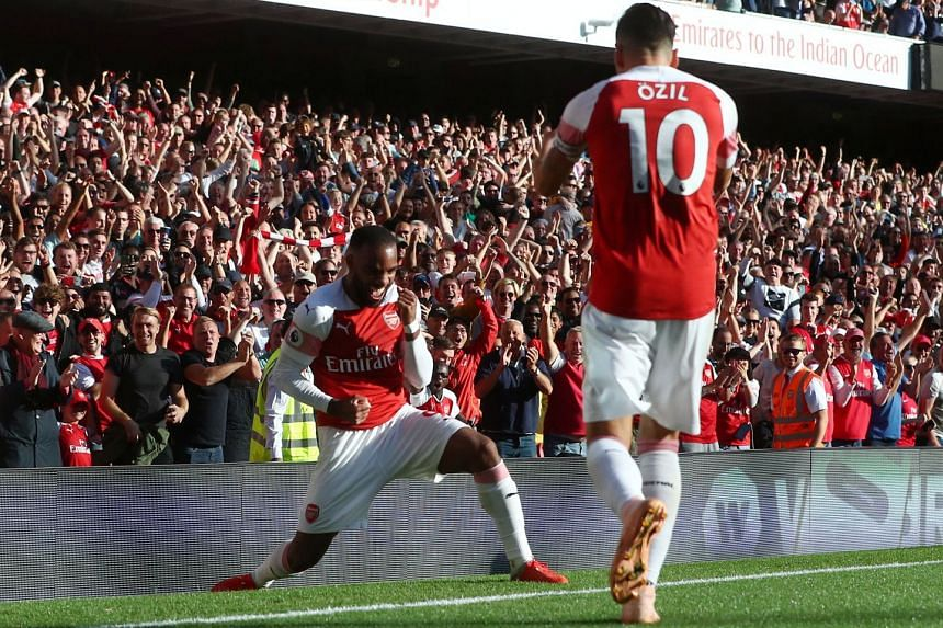 Arsenal's Mesut Ozil celebrates scoring their second goal with Alexandre Lacazette.