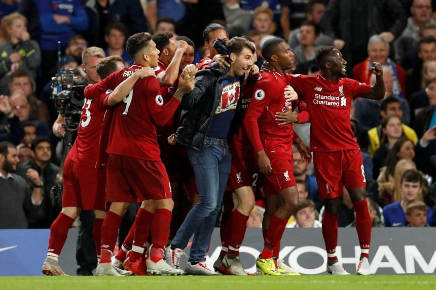 iverpool's Daniel Sturridge celebrates scoring with team mates.