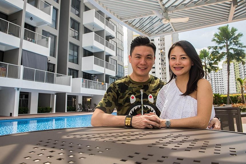 Mr Marcus Luah, senior associate district director at Propnex, with his wife Cecilia Poh, a Propnex agent, at their favourite spot in the Hillion Residences condominium, where they are renting a two-bedroom apartment. They own three properties. Mr Lu