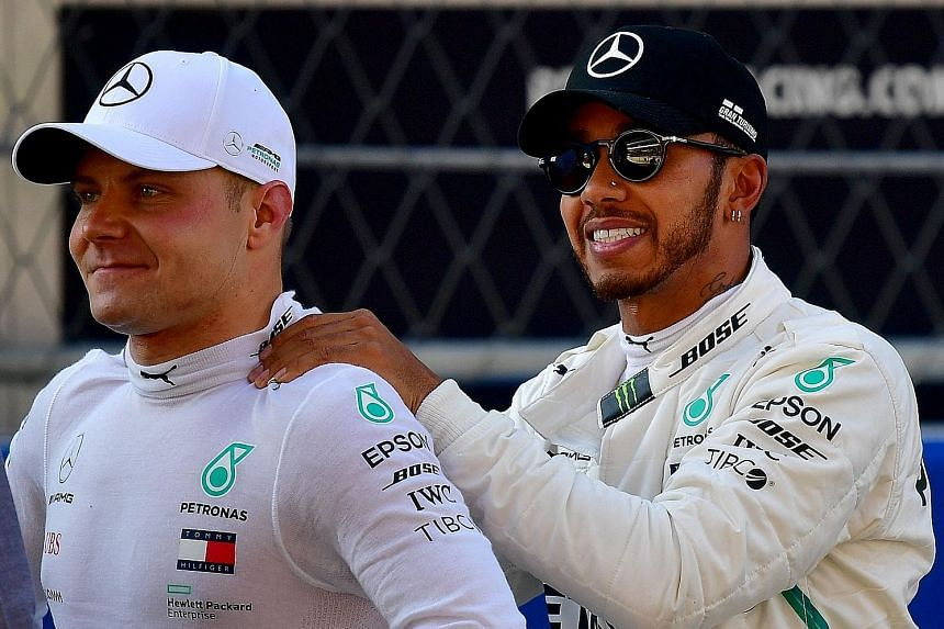 Mercedes pair Valtteri Bottas (left) and Lewis Hamilton after qualifying for the Russian Grand Prix yesterday. Bottas claimed his sixth career pole and will start ahead of his teammate.