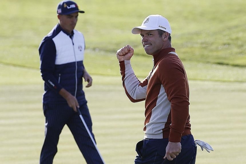 Team Europe's Paul Casey on the way to sealing an impressive 3 and 2 victory over Dustin Johnson and Rickie Fowler alongside fellow Englishman Tyrrell Hatton.