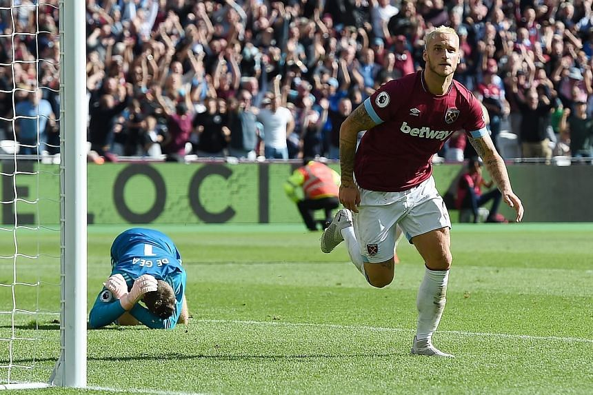 West Ham's Marko Arnautovic celebrates after scoring the third goal in his side's 3-1 Premier League win over Manchester United yesterday. United's 10 points after their opening seven games of a top-flight season is their lowest since the 1989-90 cam