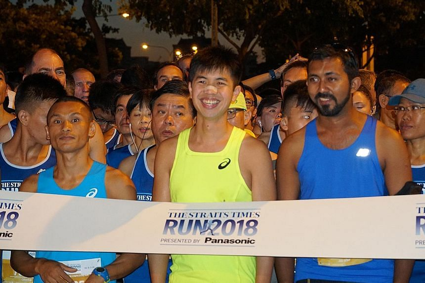 Jed Senthil (right) at the 10km start line of The Straits Times Run last weekend. He believes that every runner can play a part in giving back to altruistic causes through running.