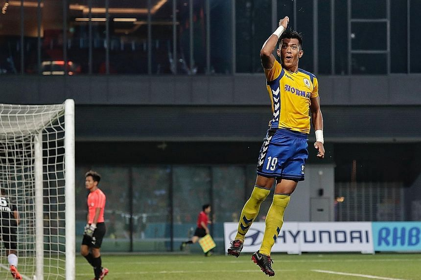Tampines Rovers' Khairul Amri jumping for joy after scoring his penalty against Home United during the 1-1 Singapore Premier League draw at Our Tampines Hub yesterday.