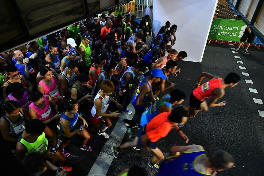 Elite runners being flagged off for the Standard Chartered Singapore Marathon last December. Readers who have been following Mok Ying Ren's ST Run training plan can continue to follow his programme to prepare for the marathon.