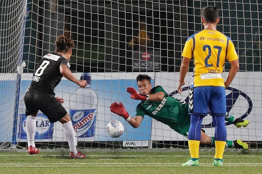 Stags goalkeeper Syazwan Buhari saving a penalty kick from Home United's Song Ui-young in stoppage time.