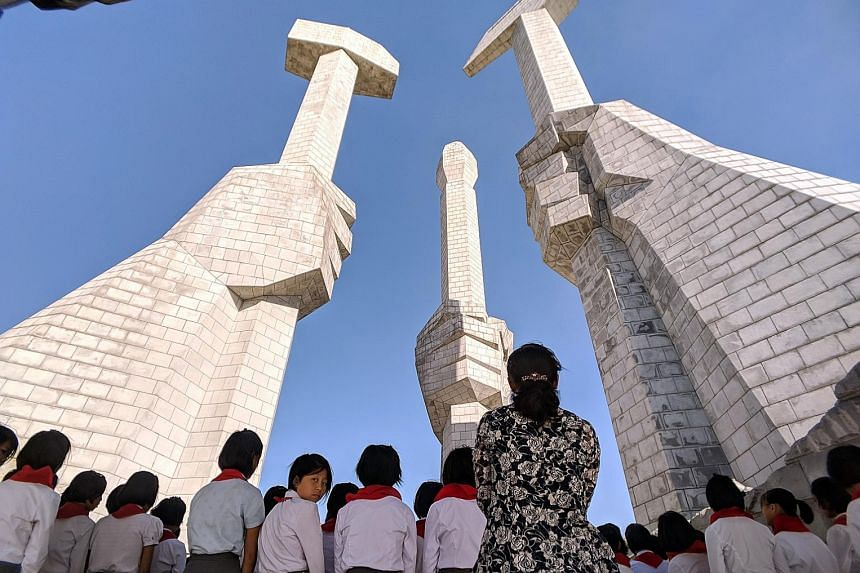 Student members of North Korea's Kimilsungist-Kimjongilist Youth League, the youth wing of the ruling party, in their signature red ties, in front of a monument that marks the founding of the Workers' Party of Korea, last Saturday.