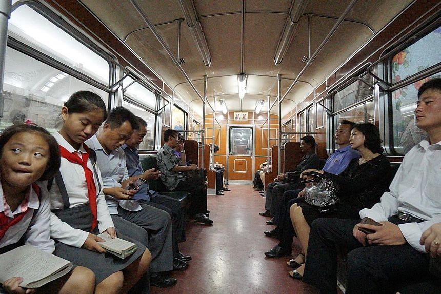 Commuters riding the Pyongyang Metro, which can double as a nuclear bunker and is said to be the world's deepest underground subway system, last Sunday.