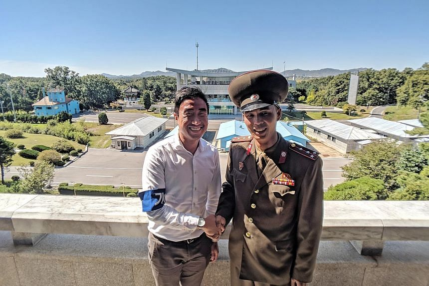 ST correspondent Walter Sim with Captain Han Guk Chol, who asked for a photo on learning Mr Sim is a Singapore journalist who covered the Panmunjom summit in April.