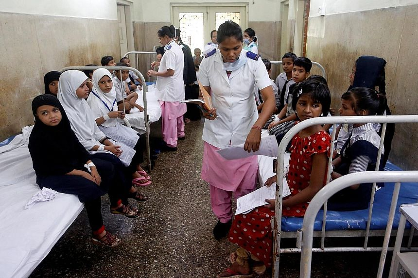 Patients at a hospital in Mumbai. Critics of a new government health insurance scheme say it is underfunded and overlooks India's grossly inadequate public health infrastructure.