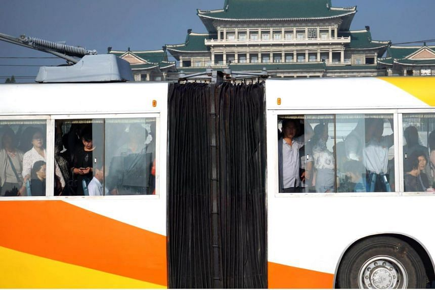 Passengers crowd on board a trolley bus during the morning peak hour in Pyongyang, on Sept 22, 2018.
