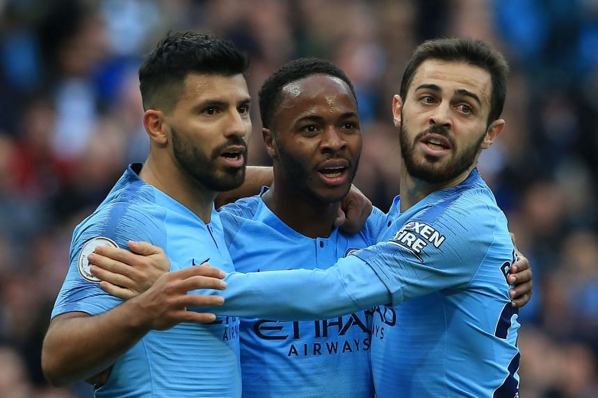 Sterling (centre) celebrates with Sergio Aguero (left) and Bernardo Silva after scoring the team's first goal.