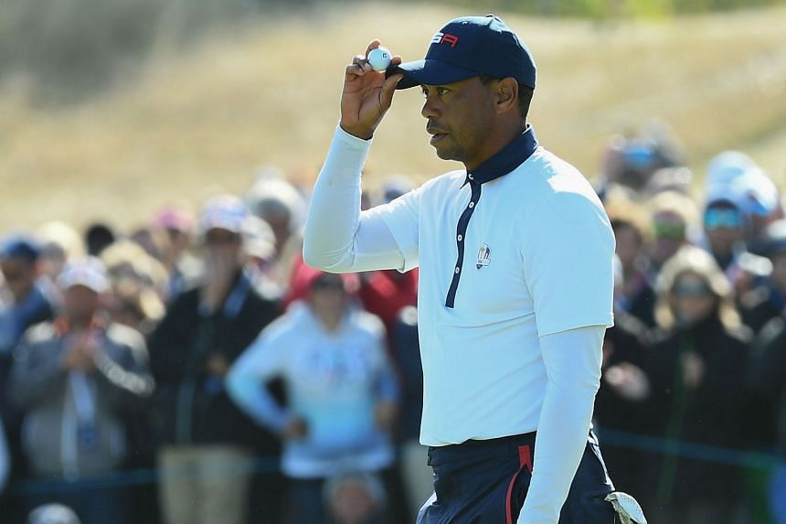 Woods reacts during his foursomes match on the second day of the 42nd Ryder Cup.