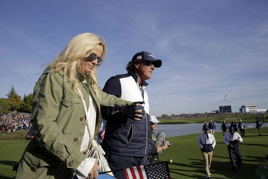 Mickelson (right) walks with his wife Amy on the second day of the 42nd Ryder Cup.