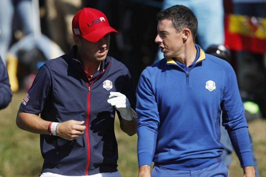 Team USA's Justin Thomas (left) talks with Team Europe's Rory McIlroy during the singles match on the third day of the Ryder Cup in Saint-Quentin-en-Yvelines, France, on Sept 30, 2018.