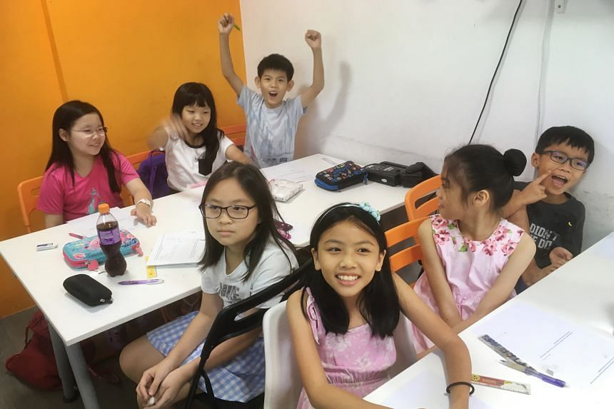 Primary 3 pupils at The Study Room, a tuition centre in Toa Payoh North. The Education Ministry last Friday announced changes in policy which included fewer mid-year exams, no more class rankings, and two test-free years for children when they start