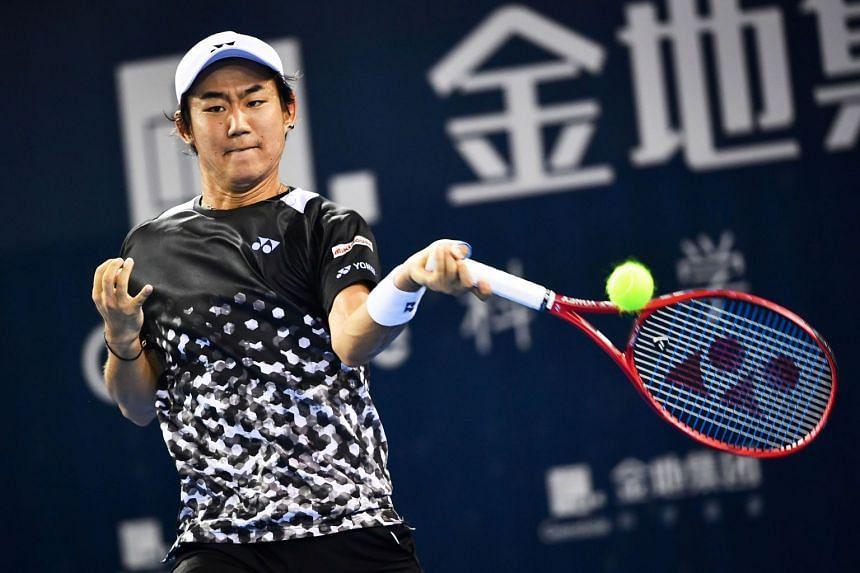Yoshihito Nishioka hits a return against Fernando Verdasco of Spain.