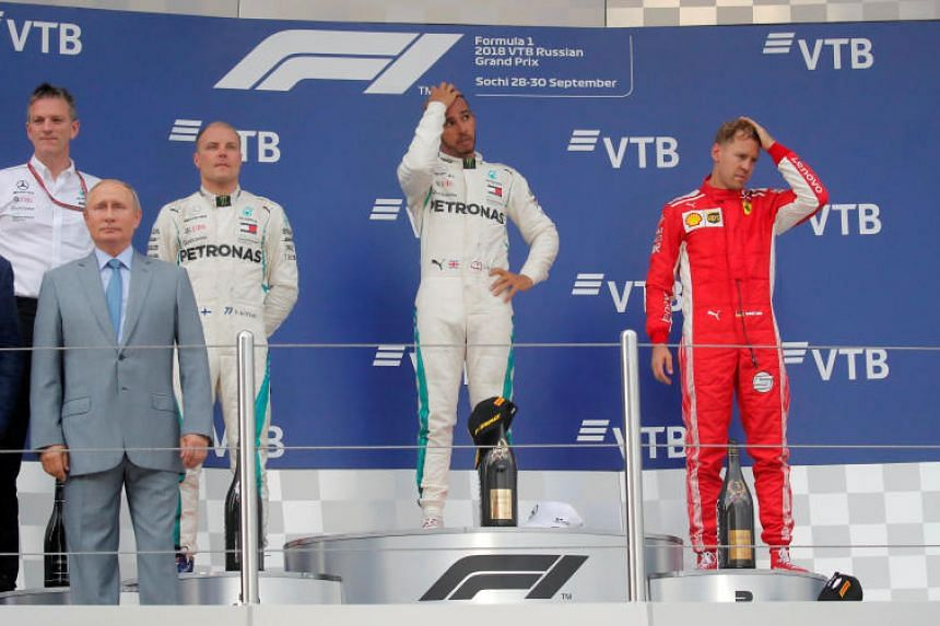 Mercedes' Lewis Hamilton (centre) celebrates on the podium after winning the Russian Grand Prix, alongside second-placed teammate Valtteri Bottas and third-placed Sebastian Vettel of Ferrari on Sept 30, 2018.