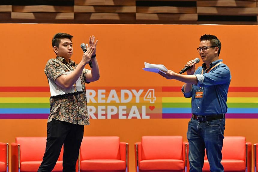 (From left) Mr Johannes Hadi and Mr Glen Goei speak at the Ready4Repeal town hall on Sept 30, 2018.