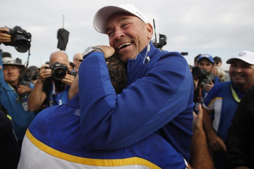 Team Europe's captain Thomas Bjorn celebrates with Francesco Molinari after winning the Ryder Cup on Sept 30, 2018.