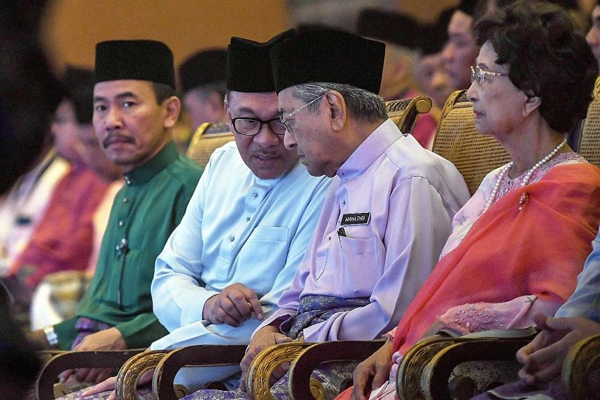 Parti Keadilan Rakyat president-elect Anwar Ibrahim chatting with Malaysian Prime Minister Mahathir Mohamad at the Future of the Bumiputera and Nation Congress 2018 in Kuala Lumpur last month. Beside them is Tun Dr Mahathir's wife Siti Hasmah Mohamad