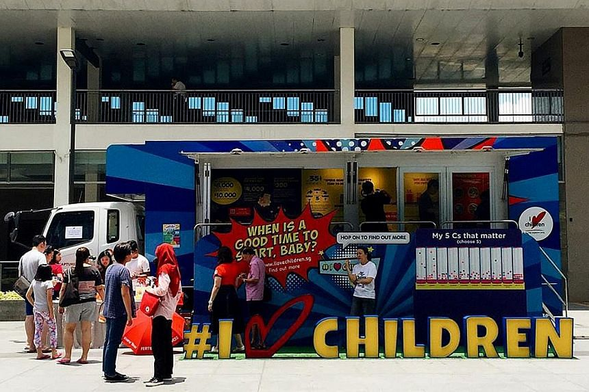 I Love Children's Truck-on-the-Go, which educates visitors on managing one's finances and understanding fertility issues, at Hillion Mall last Saturday. It will make more stops in more areas this and next month.