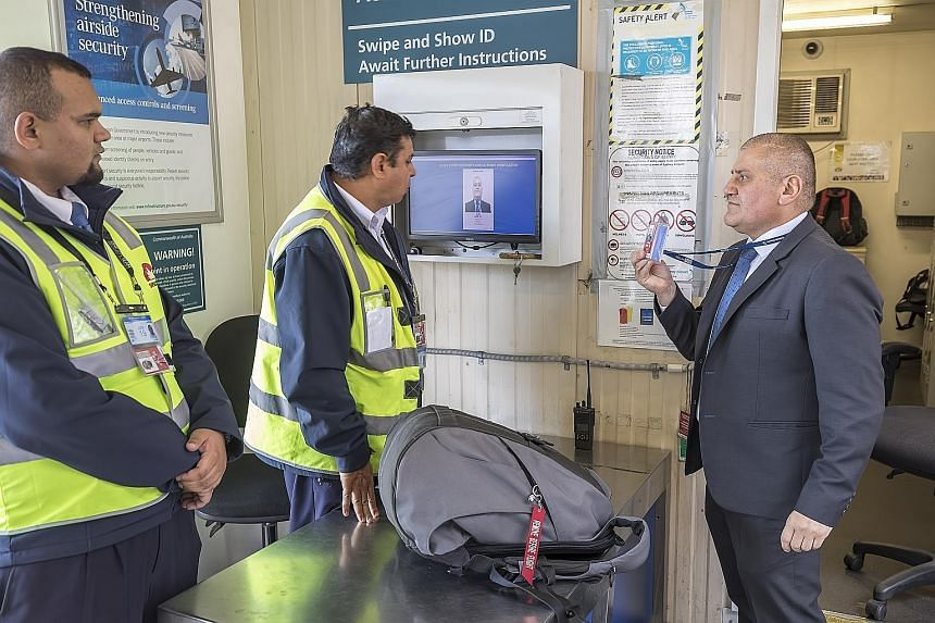 Staff of SNP Security, which was acquired by Certis earlier this year, screening checked bags for threats before the luggage is loaded onto planes at Sydney Airport. SNP has contracts with seven Australian airports.