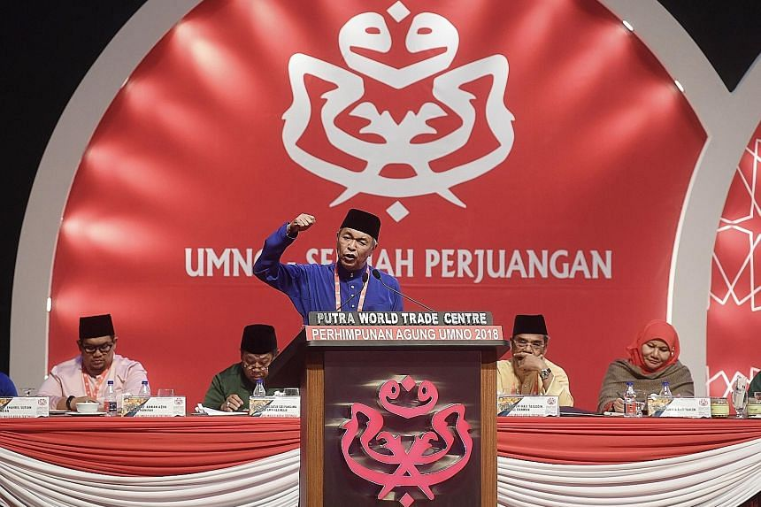 Umno president Ahmad Zahid Hamidi delivering the closing speech at the Umno general assembly. The combative tone of Mr Zahid's winding-up speech showed there are still unresolved issues in the ranks.