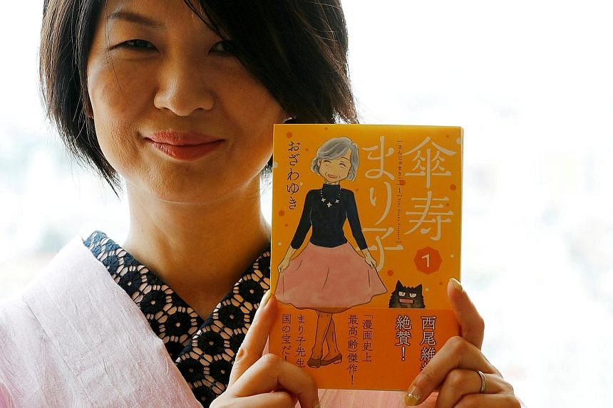 Kenshi Hirokane (left), the author of the Kosaku Shima and Like Shooting Stars In The Twilight manga series, with a cutout of his Kosaku Shima character. Yuki Ozawa (below) is the illustrator of Sanju Mariko, about an 80-year-old widow.