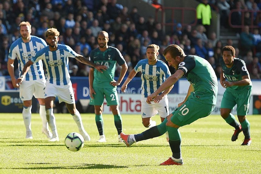 Tottenham striker Harry Kane scoring from the penalty spot to seal a 2-0 away win against Huddersfield at the John Smith's stadium on Saturday. Before the match, he had managed just one goal in six games, compared to his tally of 13 goals in eight ma