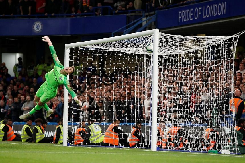 Chelsea goalkeeper Kepa Arrizabalaga grasping at thin air as substitute Daniel Sturridge's effort from outside the box flies past the Spaniard for Liverpool's equaliser in the 89th minute at Stamford Bridge on Saturday. The 1-1 draw ensured that the