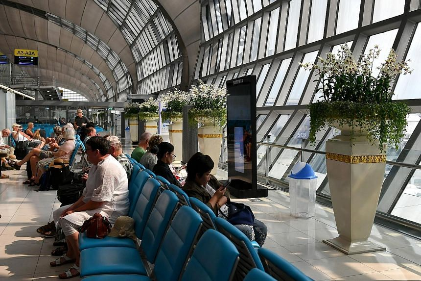Passengers at Suvarnabhumi Airport in Bangkok. The number of flights could triple to more than 20,000 a day in 15 years, says the UN's International Civil Aviation Organisation.