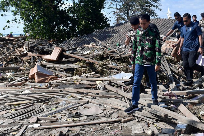 Indonesian President Joko Widodo visits an area affected by an earthquake and tsunami in Palu, Sulawesi, on Sept 30, 2018.
