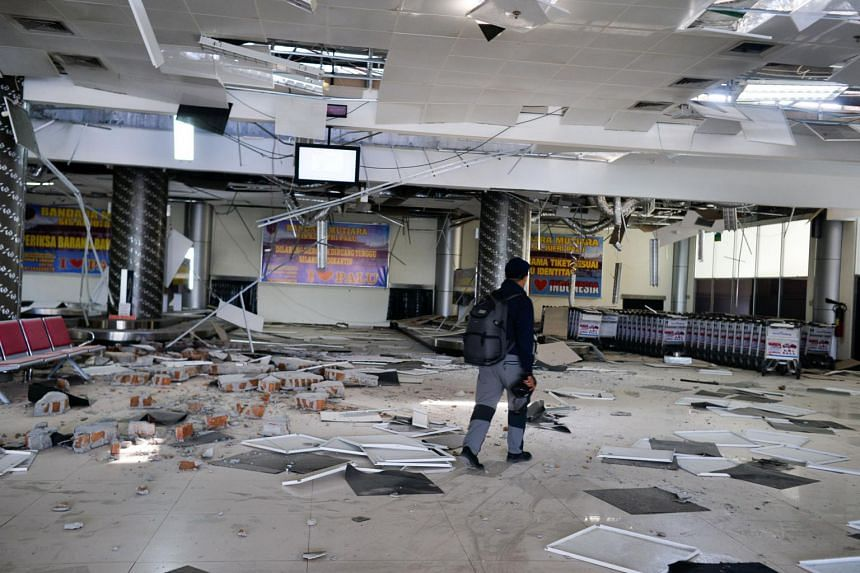 A man walks inside a damaged area at an airport during the aftermath of earthquake in Palu, Indonesia, on Sept 30, 2018.