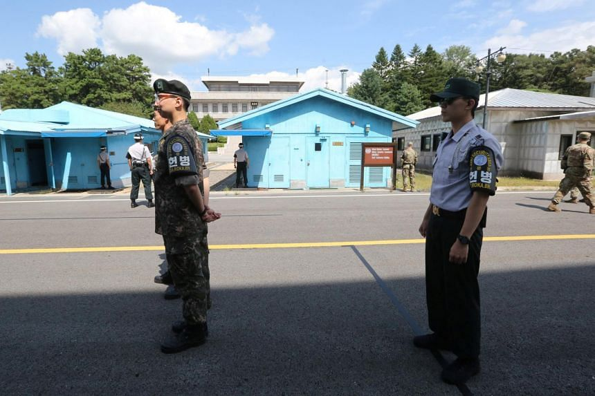 South Korean soldiers standing guard at Panmunjom. North and South Korea agreed to remove all landmines in the so-called Joint Security Area within the next 20 days.