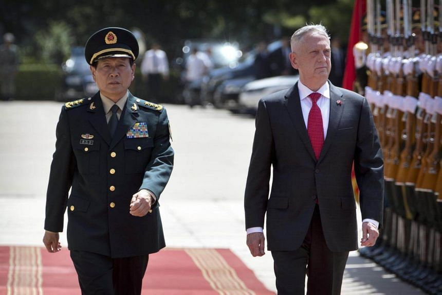 China's Defence Minister Wei Fenghe and US Defence Secretary Jim Mattis review an honour guard during a welcome ceremony at the Bayi Building in Beijing, on June 27, 2018.